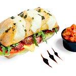Ciabatta with Black Angus sausage /tomatoes, rocket, iceberg, pesto, cheddar cheese/