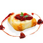 Baked Kamembert in filo pastry with homemade strowberry jam.