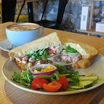 Crayfish and mango sandwich and cappuccino.