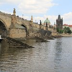Old town tower seen from the other side of the river Vltava, Prague