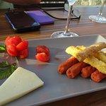 Cheese, bread sticks and tomato snacks.