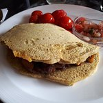 Chilli-Chorizo Chickpea Omelette with tomatoes and salsa.