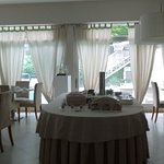 Beautiful Breakfast room overlooking pool.