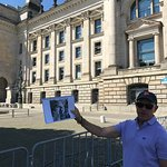 Jeremy in front of the Reichstag, with historical photo from the same spot