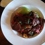 Wok Sauteed Beef Tenderloin with young Bok Choi cabbage and potato cake in Madeira wine.