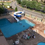 Picture of the pool and slide. The lazy river at the bottom of the photo.