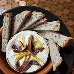 Oven baked camembert with preserved lemon, garlic & anchovies