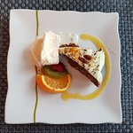 A very yummy carrot cake and vegan ice cream for desert with fresh fruit garnish.