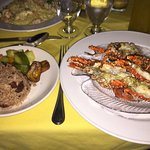 Grilled crayfish served with garlic butter sauce; rice & vegetables. I also had a local passion