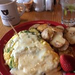 Four egg cheese and avocado omelet with home fries