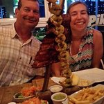 Huge skewers with sides and dipping sauces