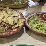 Refried beans with corn and guacamole side dishes