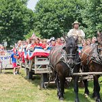 Visitors participate in the town parade at the 1875 Independence Day celebration.
