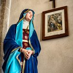 Mary and a station of the cross.