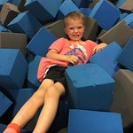 You jump off of the trampolines into this foam pit. I tried it, too, and it was fun.