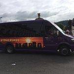 Scarper Tours purple bus.