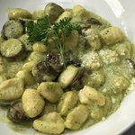 homemade gnocchi with Italian sausage in a pesto sauce