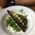 grilled pike over greens