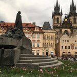 Sculpture of Jan Huss and the Tyn Church in the background, old town Prague