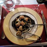 """Entree of Burgandy snails (escargot) along with accompanying pinces à escargots or """"snail tongs"""""""