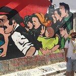 Rafal explaining the meaning behind Lisbon's political artwork.