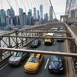 iconic shot of Manhattan and yellow cab