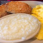 Pork chops and eggs with a side of grits