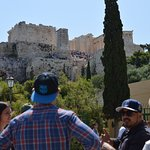 Jimmy, guide, and group in front of Acropolis