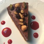 Barbetta rich chocolate tart with raspberry coulis