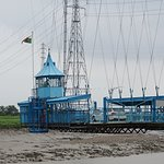 Car travels on Newport Transporter Bridge