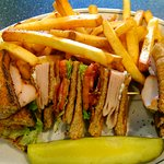 Turkey Club Sandwich with mayo on brown bread served with FF.