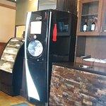 Dessert case and soda machine.