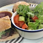 FILLET STEAK SANDWICH with caramelised red onion chutney and rocket, served with beef dripping s