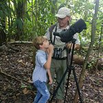 Victor showing our son the wonders of the jungle.