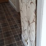 Peeling wall paper in the hall