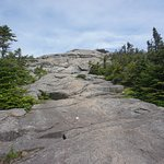 The rock climb up to the summit. there are markers on how to climb up. Not difficult