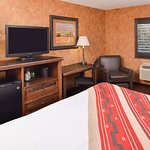 King Bed Guest Room with Chair