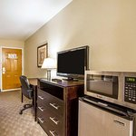 Guest room with microwave and refrigerator