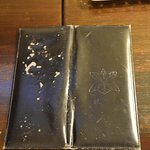 Torn room service book