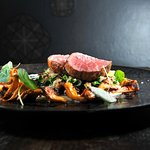 VEAL FILLET AND BEEF RIBS WITH SAVOY CABBAGE, chanterelle mushrooms, onion pureé with parm
