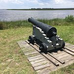 a cannon aimed over the surrounding water