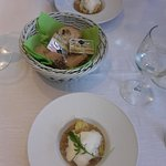 A complimentary taster of tiny ravioli in mushroom sauce with parmesan foam