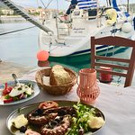 Jump from your boat to the taverna :)