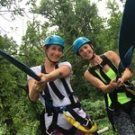 Zip line and dangling off the edge from the wooden posts