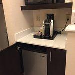 Pods coffee machine, microwave, and a fridge