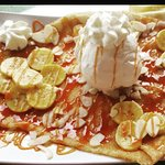 Crêpe homemade salted butter caramel, fresh banana, almonds and coconut ice cream with cream