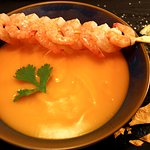Tomato ginger soup finished with coconut cream! Additional grilled prawn skewer!Gluten, lactose