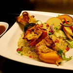 Chicken skewer served on  veggie Cous Cous  with spicy chicken gravy.