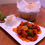 Spicy fish and prawn devilled served with Basmathi rice