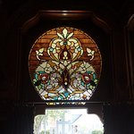 Beautiful stained glass is throughout house